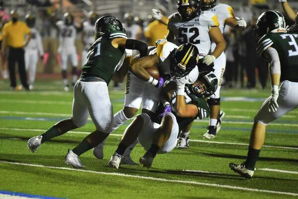 Brennan's Jalin Spells gets into the end zone for one of his two first quarter touchdowns versus Reagan during their game Saturday night at Commalander Stadium.