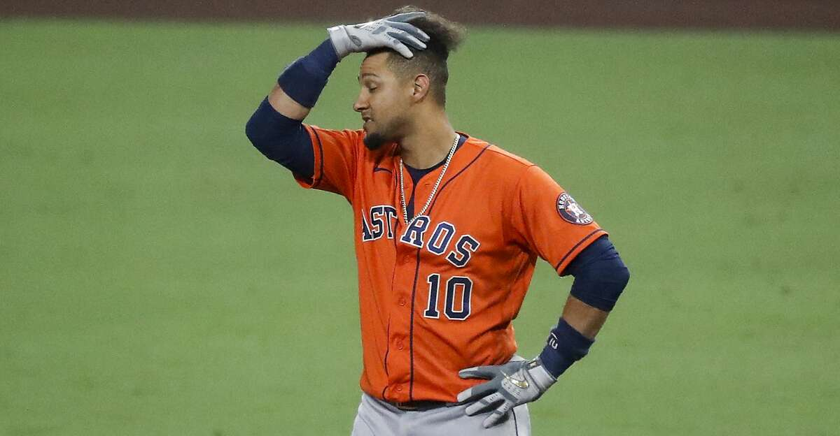 Houston Astros Yuli Gurriel reacts after hitting into an inning-ending double play against the Tampa Bay Rays during the seventh inning of Game 7 of the American League Championship Series at Petco Park Saturday, Oct. 17, 2020, in San Diego.