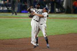 SAN DIEGO, CALIFORNIA - OCTOBER 17: Randy Arozarena #56 and Willy Adames #1 of the Tampa Bay Rays celebrate a 4-2 win against the Houston Astros to win the series in Game Seven of the American League Championship Series at PETCO Park on October 17, 2020 in San Diego, California. (Photo by Ezra Shaw/Getty Images)