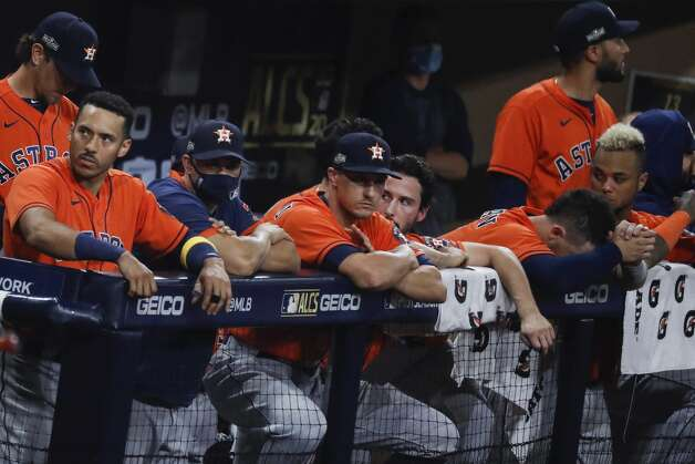 The Houston Astros dugout watch the end of the night inning as the Tampa Bay Rays eliminated the Astros with a 4-2 win in Game 7 of the American League Championship Series at Petco Park Saturday, Oct. 17, 2020, in San Diego. Photo: Karen Warren/Staff Photographer / © 2020 Houston Chronicle