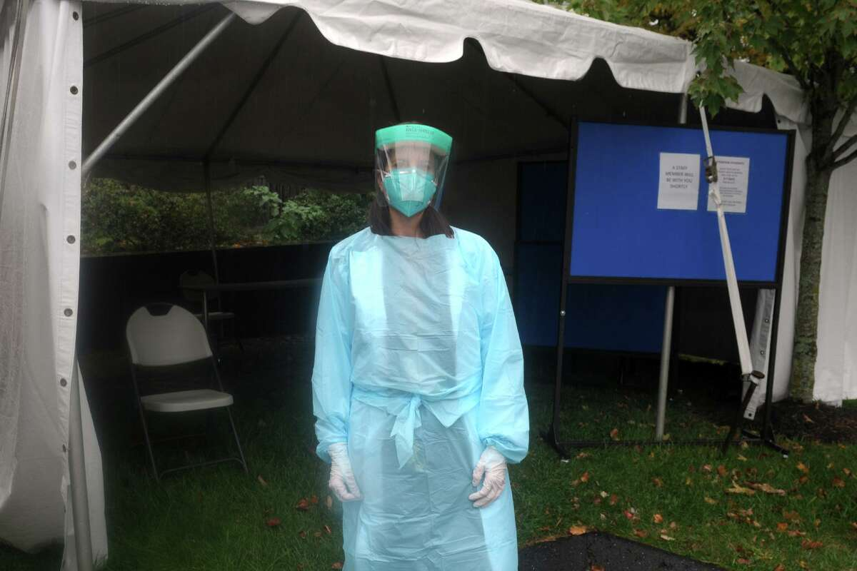 Dr. Betsy Clachko, medical director of student health services at Sacred Heart University, stands in front of a tent where COVID tests are administered to students in Fairfield, Conn. Oct. 16, 2020.