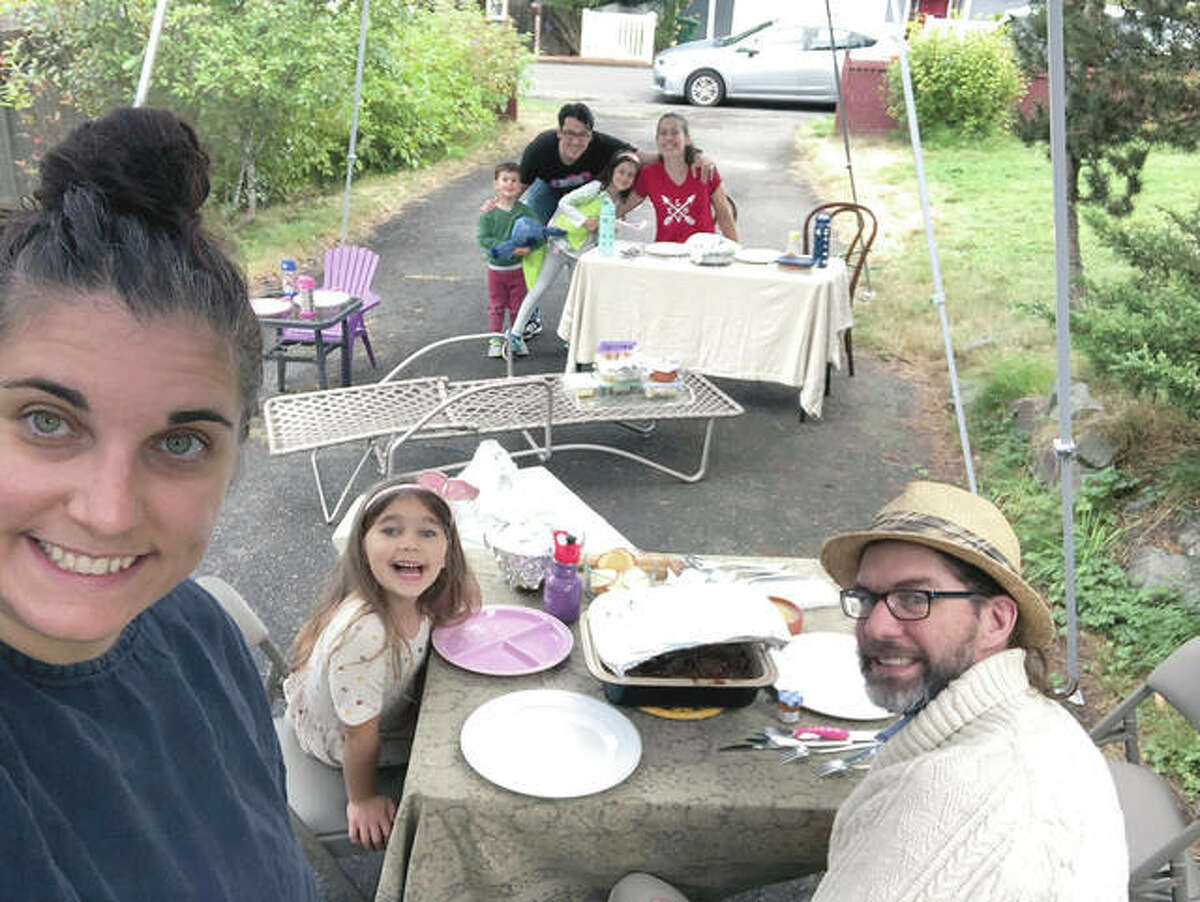 With COVID-19 making indoor dinners with friends a potential health risk, Jennifer Fliss (front left) held a socially distanced Rosh Hashanah supper with neighbors in her driveway this year in September. She'll likely do the same for Thanksgiving this year.