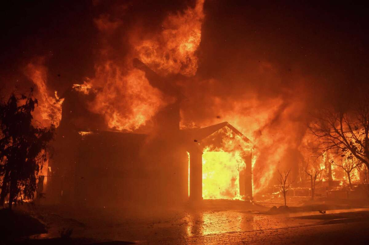 Fire engulfs a home in the Skyhawk Park neighborhood of East Santa Rosa during the Shady Fire in Sonoma County, Calif., on Sept. 28, 2020.