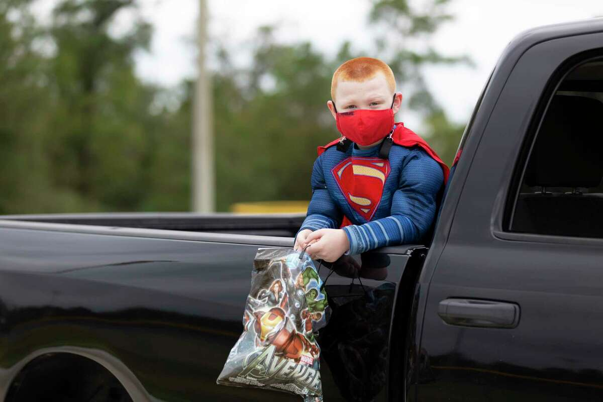 Brandon Collins, 6, dresses up at Superman during an annual Halloween event hosted by the Conroe Parks and Recreation department.