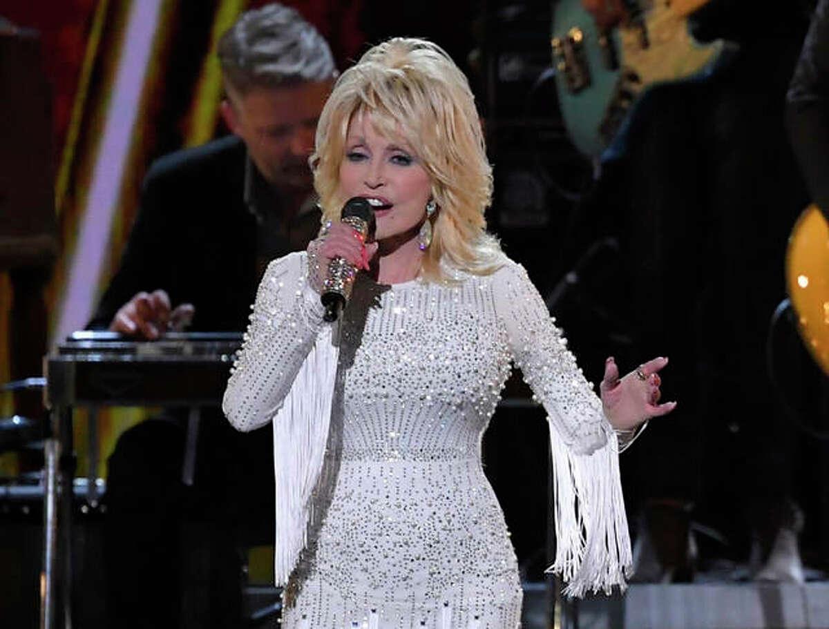This Nov. 13, 2019 file photo shows Dolly Parton performing at the 53rd annual CMA Awards in Nashville, Tenn.