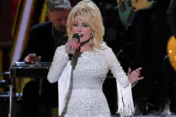 This Nov. 13, 2019 file photo shows Dolly Parton performing at the 53rd annual CMA Awards in Nashville, Tenn.