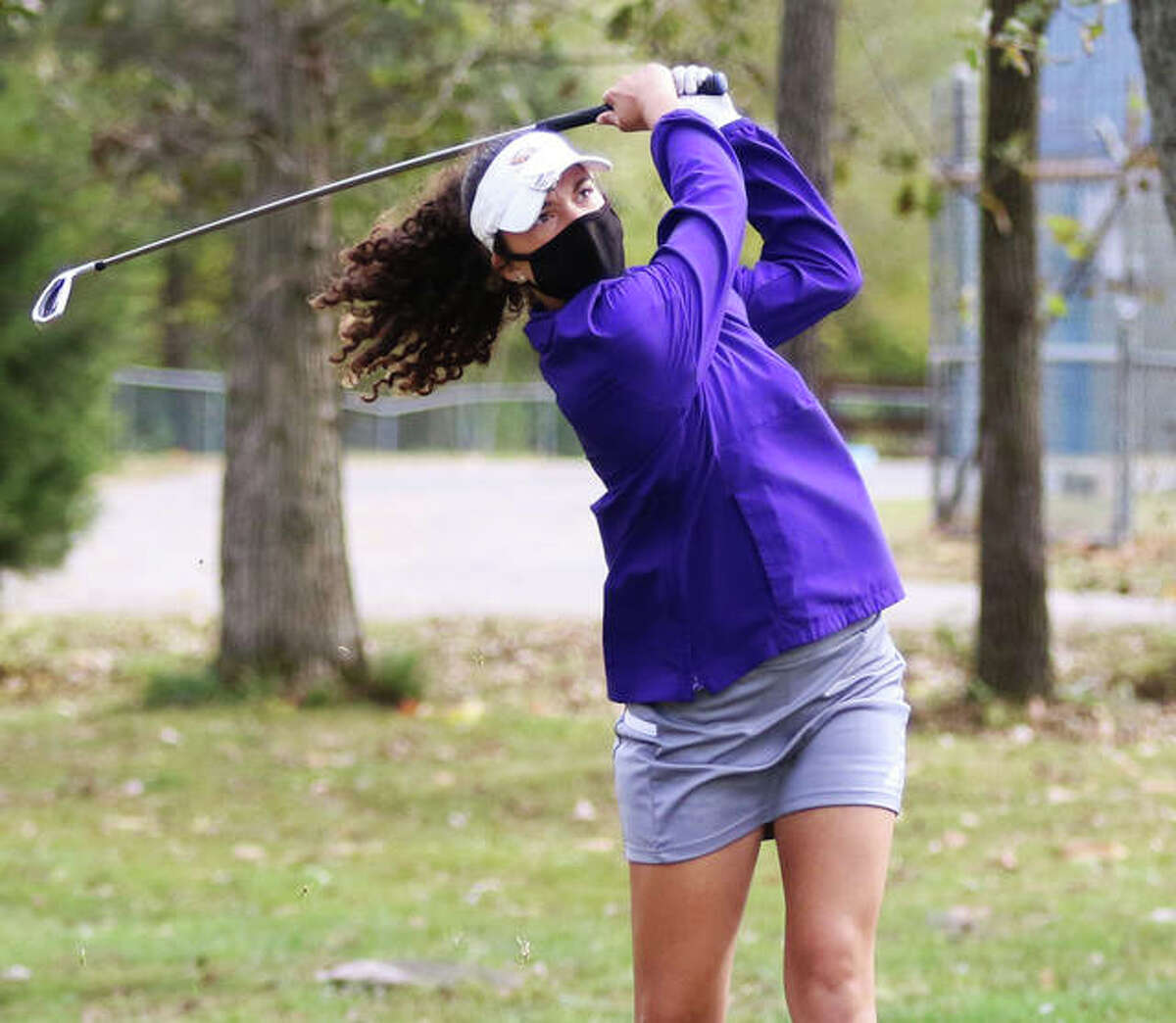 CM sophomore Sophee Brown watches her shot in the Salem Class 1A Sectional last week at Salem Country Club. Brown was the Eagles' No. 1 player while earning first team All-MVC honors.