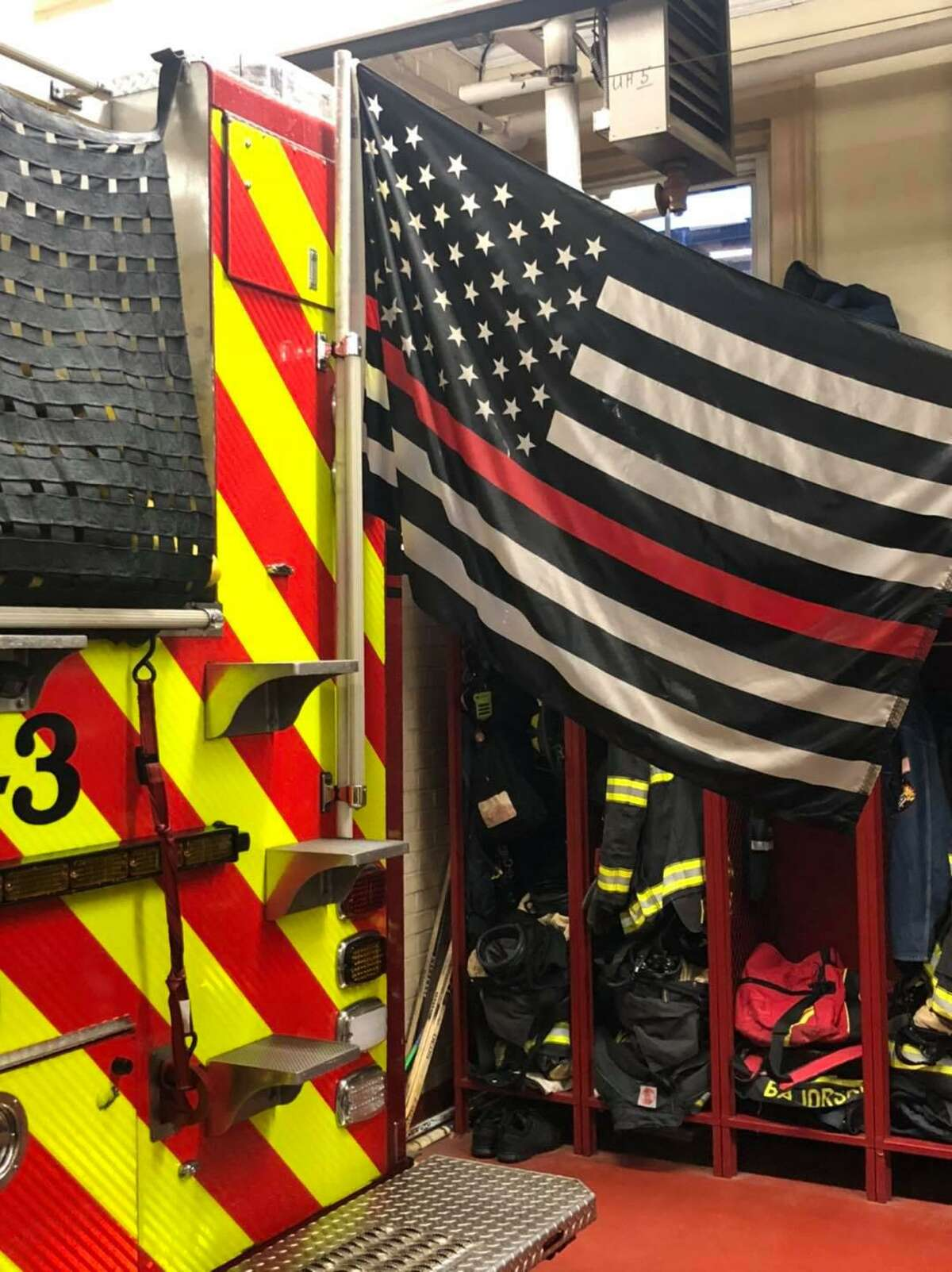 """A """"Thin Red Line"""" flag, honoring fallen firefighters, was stolen off a Middletown Fire Department vehicle during a call Friday, Oct. 16."""