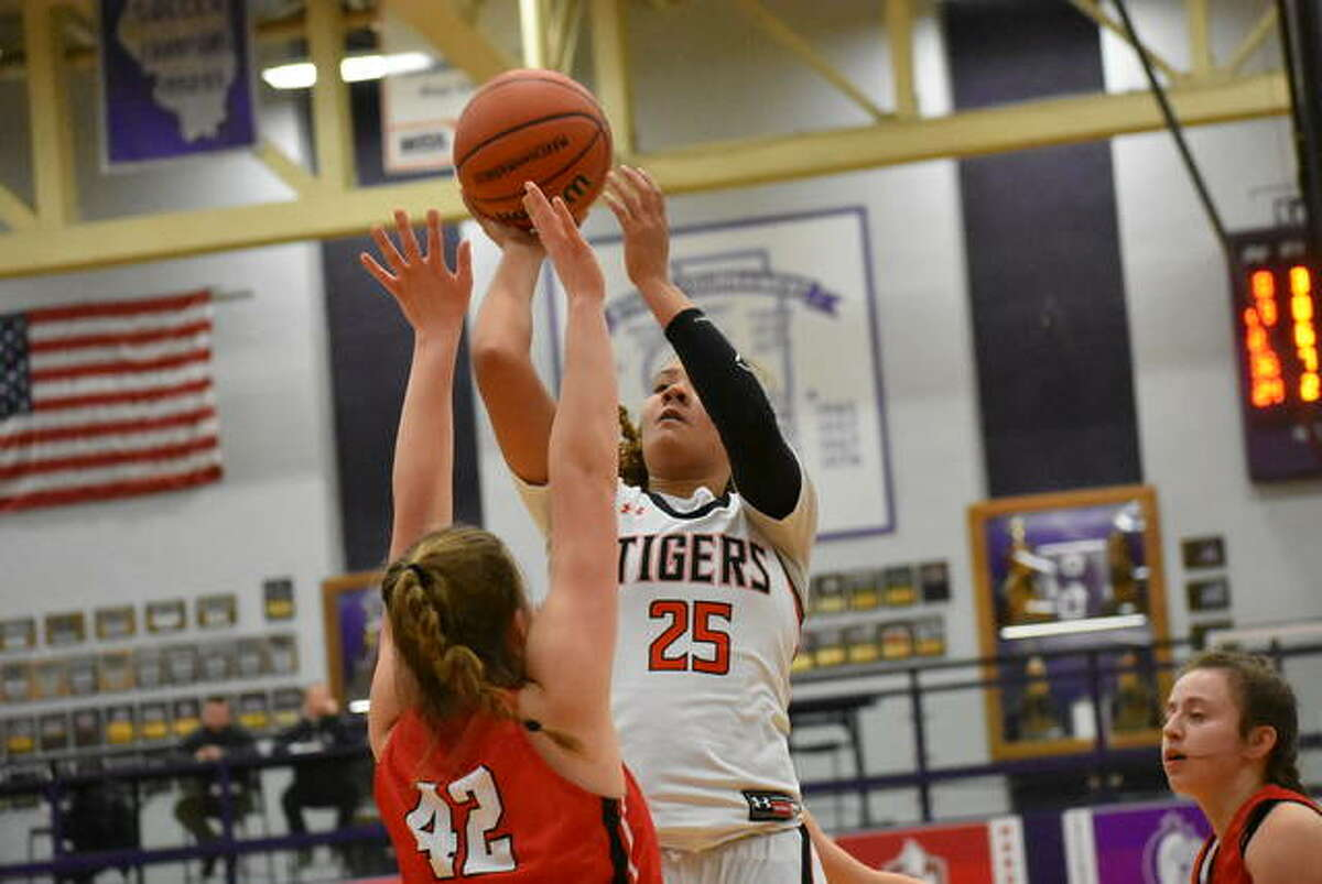 Edwardsville's Sydney Harris puts up a jump shot during the Class 4A Collinsville Regional semifinal game last year.