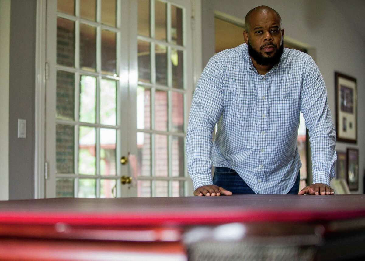 Edwin Smith poses for a photograph inside his mother-in-law's homeon Friday, Oct. 9, 2020, in Houston. Smith was recently laid off in late March at a software company, and has been appyling for jobs full time since.