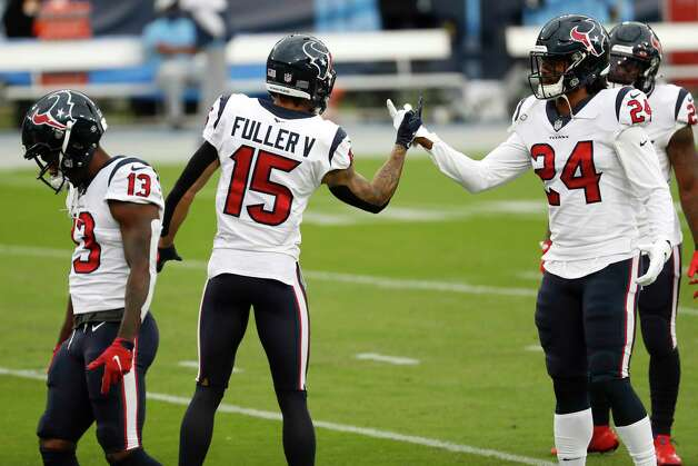 Houston Texans wide receivers Brandin Cooks (13), Will Fuller (15) and running back C.J. Prosise (24) warm up before an NFL football game against the Tennessee Titans at Nissan Stadium on Sunday, Oct. 18, 2020, in Nashville. Photo: Brett Coomer, Staff Photographer / © 2020 Houston Chronicle