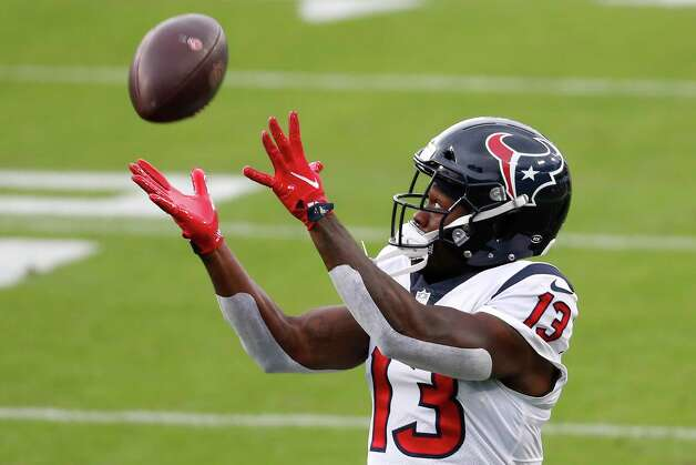 Houston Texans wide receiver Brandin Cooks reaches out to make a catch as he warms up before an NFL football game against the Tennessee Titans at Nissan Stadium on Sunday, Oct. 18, 2020, in Nashville. Photo: Brett Coomer, Staff Photographer / © 2020 Houston Chronicle