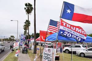 Political supporters are pictured on Friday outside the City of Laredo Fire Station where early voting is taking place.