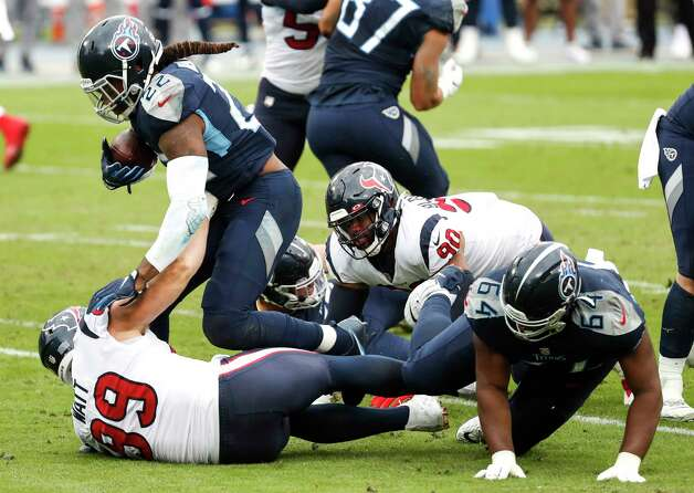 Tennessee Titans running back Derrick Henry (22) is stopped for a loss by Houston Texans defensive end J.J. Watt (99) during the first half of an NFL football game at Nissan Stadium on Sunday, Oct. 18, 2020, in Nashville. Photo: Brett Coomer, Staff Photographer / © 2020 Houston Chronicle