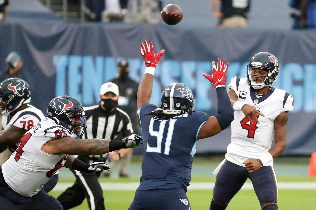 Houston Texans quarterback Deshaun Watson (4) passes the ball over Tennessee Titans defensive tackle Larrell Murchison (91) during the first half of an NFL football game at Nissan Stadium on Sunday, Oct. 18, 2020, in Nashville.