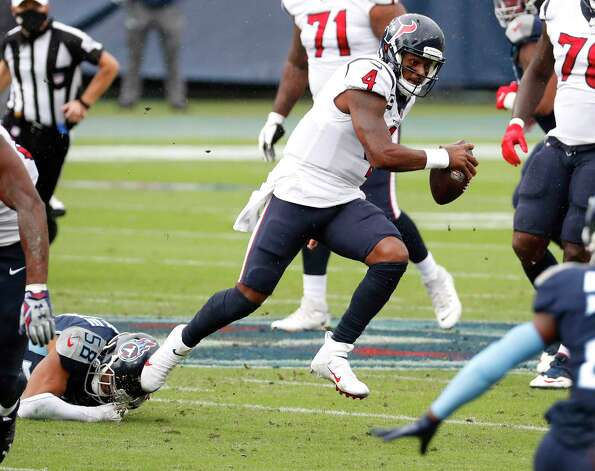 Houston Texans quarterback Deshaun Watson (4) scrambles out of the pocket out of the grasp of Tennessee Titans outside linebacker Harold Landry (58) during the first half of an NFL football game at Nissan Stadium on Sunday, Oct. 18, 2020, in Nashville. Photo: Brett Coomer, Staff Photographer / © 2020 Houston Chronicle