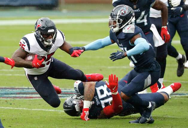 Houston Texans running back Duke Johnson (25) dives for extra yardage against the Tennessee Titans during the first half of an NFL football game at Nissan Stadium on Sunday, Oct. 18, 2020, in Nashville. Photo: Brett Coomer, Staff Photographer / © 2020 Houston Chronicle