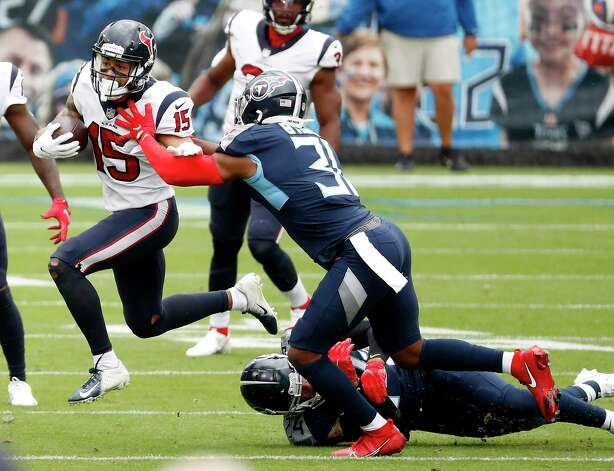 Houston Texans wide receiver Will Fuller (15) is brought down by Tennessee Titans free safety Kevin Byard (31) after making a first down reception during the first half of an NFL football game at Nissan Stadium on Sunday, Oct. 18, 2020, in Nashville. Photo: Brett Coomer, Staff Photographer / © 2020 Houston Chronicle