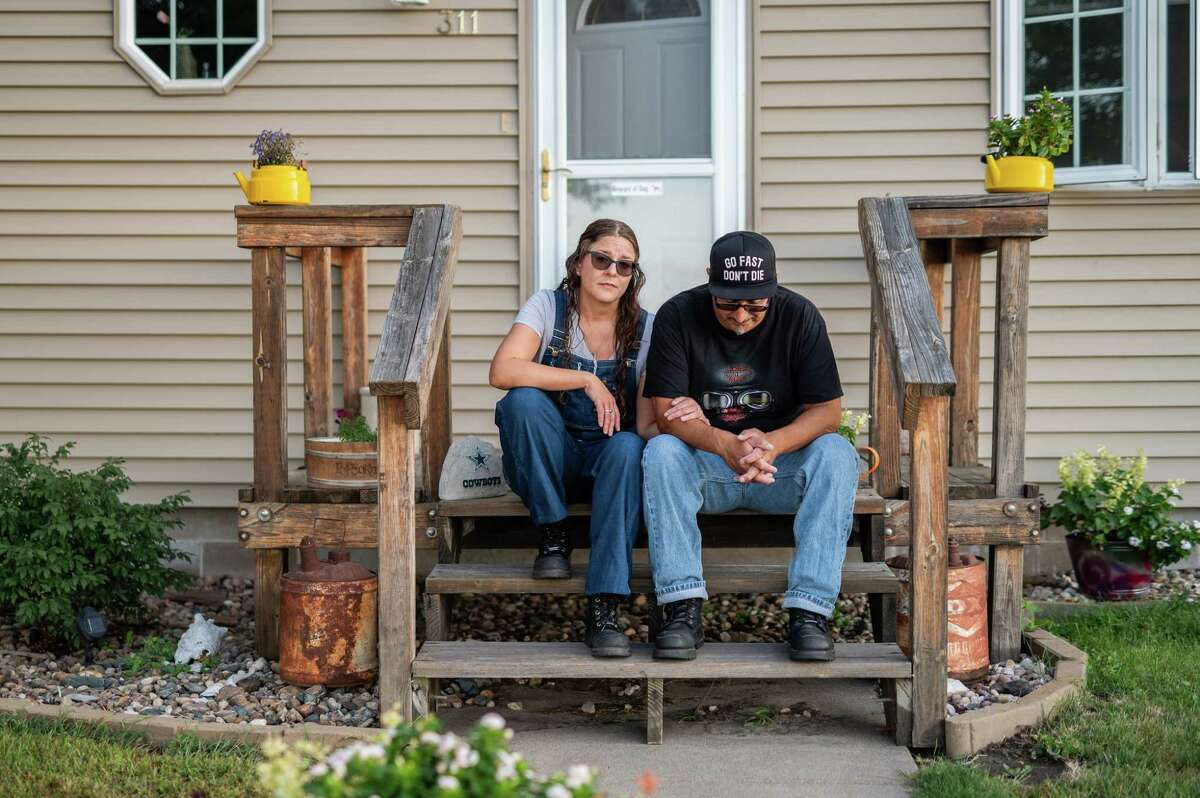 Angie Balcom and Kenny Cervantes at home in Riverdale, Neb. Cervantes told a health department tracer he got sick after attending the motorcycle rally, but his was not classified as a Sturgis case, suggesting that even in the best circumstances, infections may go uncounted.