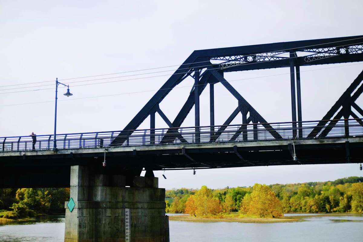 A man takes in the view from the Second Street Bridge over the Mohawk River on Sunday, Oct. 18, 2020, in Cohoes, N.Y. (Paul Buckowski/Times Union)