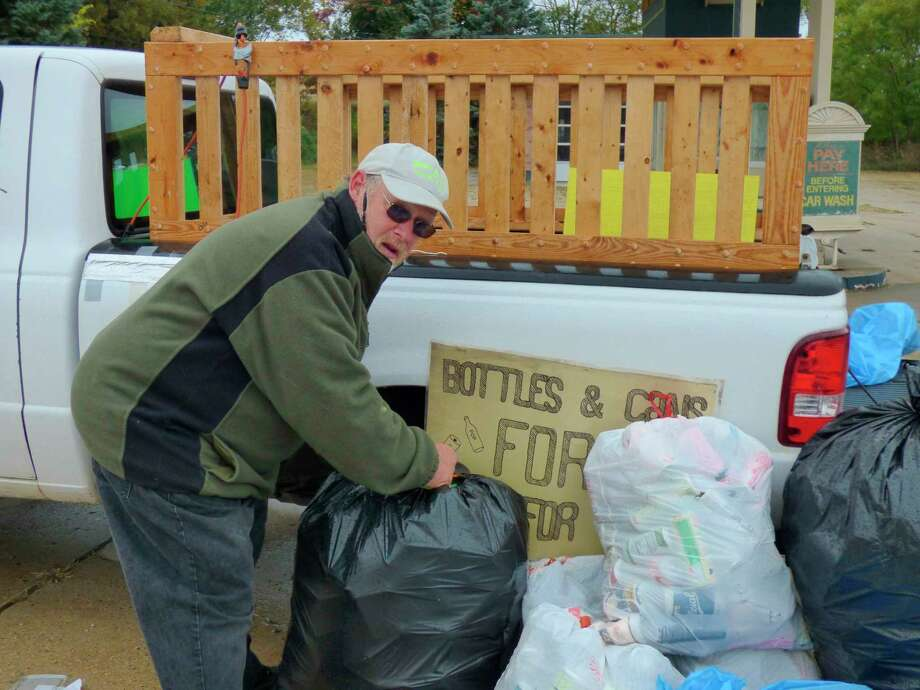 Kaleva resident, Timothy Dean gathers cans and bottles which he recycles into money for charity. (Scott Fraley/News Advocate)