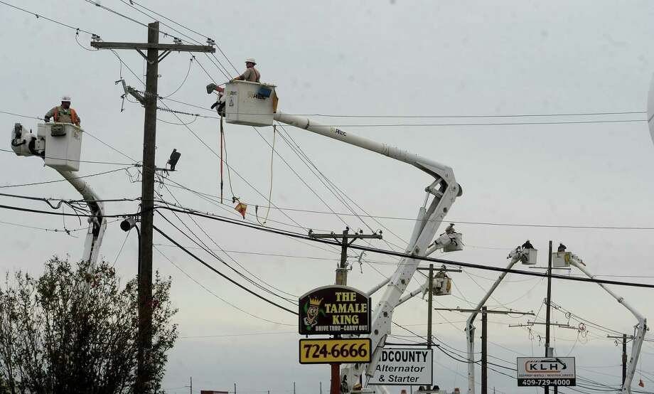 Dozens of linemen trucks stretched the length of Twin City Highway in Nederland Saturday as repairs to power lines are ongoing. Photo taken Saturday, October 17, 2020 Kim Brent/The Enterprise Photo: Kim Brent / The Enterprise / BEN