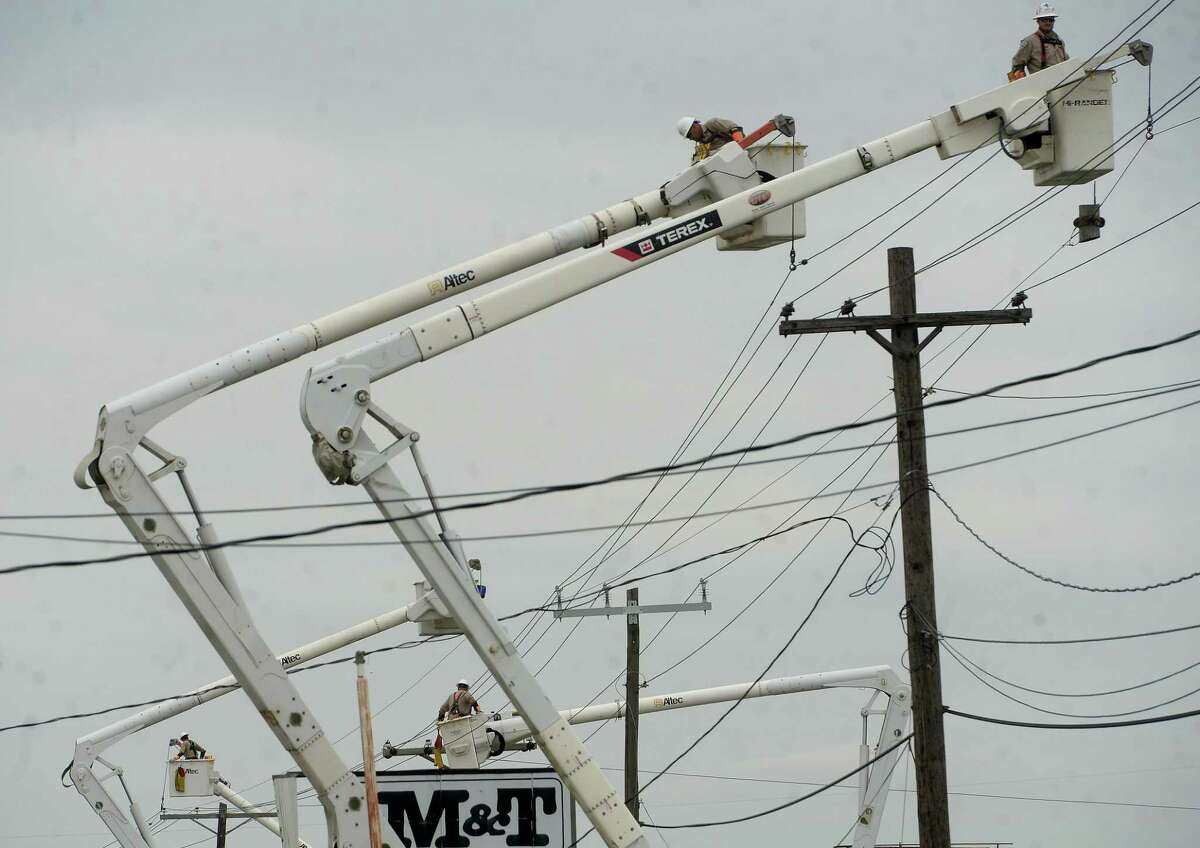 Dozens of linemen trucks stretched the length of Twin City Highway in Nederland Saturday as repairs to power lines are ongoing. Photo taken Saturday, October 17, 2020 Kim Brent/The Enterprise