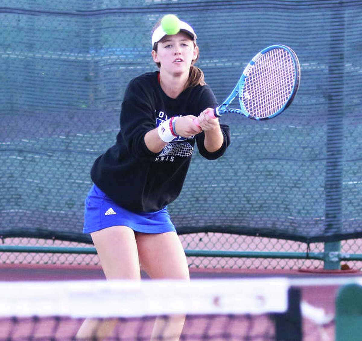 Roxana junior Lindsey Ratliff makes a backhand return Friday in a doubles match at the Althoff Class 1A Sectional at Belleville West.