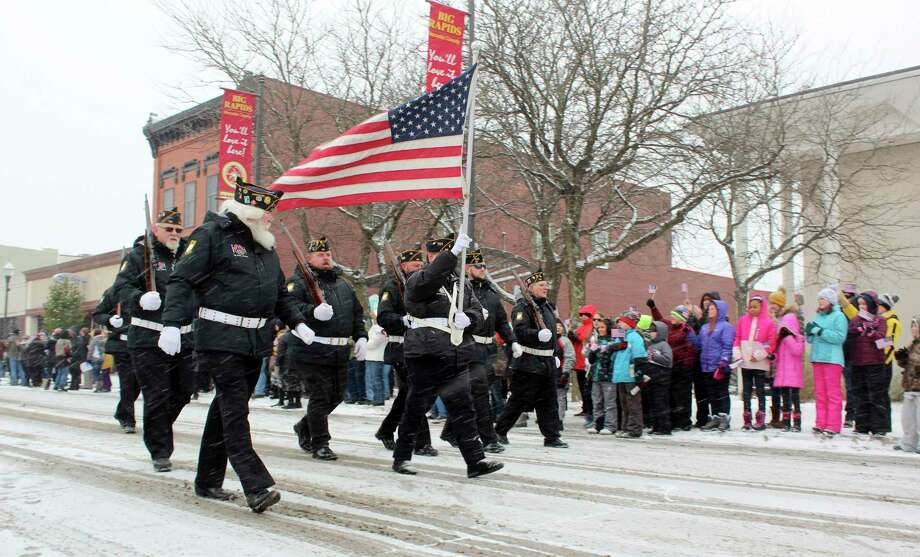 In this Nov. 11, 2019 Pioneer file photo, a group of veterans is pictured marching through downtown Big Rapids. Cold weather and snowy conditions didn't stop last year's Veterans Days parade from taking place, however, due to COVID-19 concerns, this year's parade has been cancelled. (Pioneer file photo)