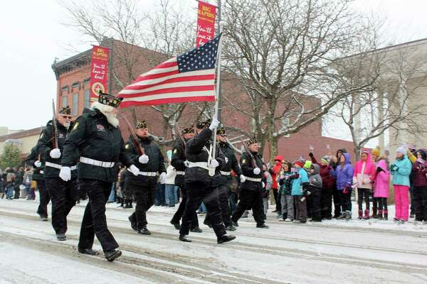 In this Nov. 11, 2019 Pioneer file photo, a group of veterans is pictured marchingthrough downtown Big Rapids. Cold weather and snowy conditions didn't stop last year's Veterans Days parade from taking place, however, due to COVID-19 concerns, this year's parade has been cancelled. (Pioneer file photo)