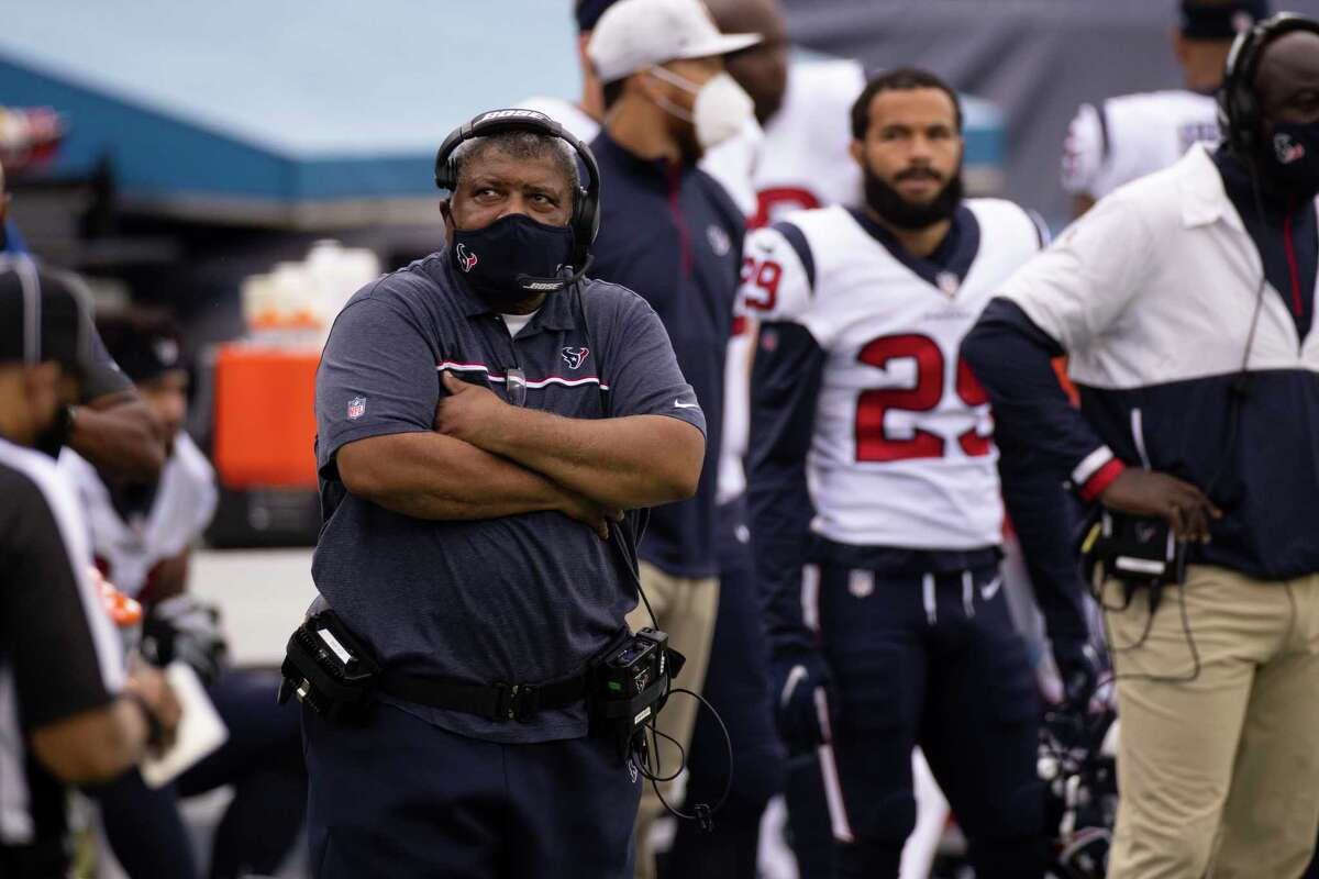 Houston Texans interim head coach Romeo Crennel watches from the sideline during the second half of an NFL football game against the Tennessee Titans, Sunday, Oct. 18, 2020, in Nashville, Tenn. (AP Photo/Brett Carlsen)