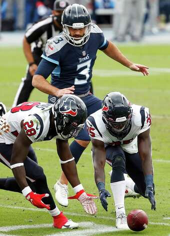 Houston Texans defensive back Michael Thomas (28) and cornerback Keion Crossen (35) and Tennessee Titans kicker Stephen Gostkowski (3) chase after for a loose ball after the Texans blocked a Gostkowski field goal attempt during the third quarter of an NFL football game at Nissan Stadium on Sunday, Oct. 18, 2020, in Nashville. Photo: Brett Coomer, Staff Photographer / © 2020 Houston Chronicle