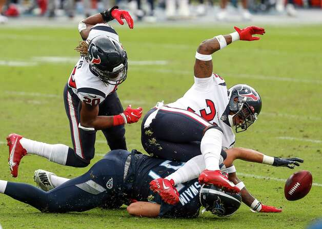 Houston Texans strong safety Justin Reid (20) and cornerback Lonnie Johnson (32) fight with Tennessee Titans tight end Geoff Swaim (87) for a loose ball after the Texans blocked a Titans field goal attempt during the third quarter of an NFL football game at Nissan Stadium on Sunday, Oct. 18, 2020, in Nashville. Photo: Brett Coomer, Staff Photographer / © 2020 Houston Chronicle