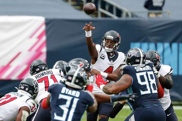Houston Texans quarterback Deshaun Watson (4) throws to running back David Johnson (31) against the Tennessee Titans during the first half of an NFL football game at Nissan Stadium on Sunday, Oct. 18, 2020, in Nashville. Photo: Brett Coomer, Staff Photographer / © 2020 Houston Chronicle