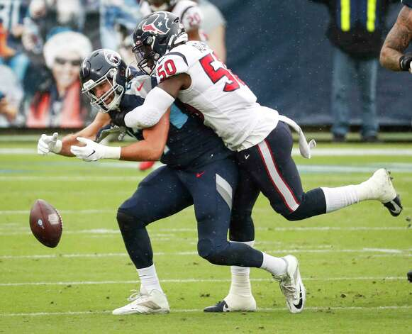 Houston Texans linebacker Tyrell Adams (50) breaks up a pass intended for Tennessee Titans tight end Geoff Swaim (87) during the first half of an NFL football game at Nissan Stadium on Sunday, Oct. 18, 2020, in Nashville. Photo: Brett Coomer, Staff Photographer / © 2020 Houston Chronicle
