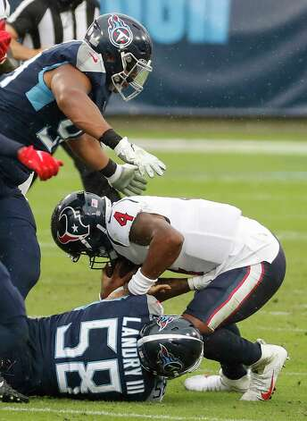 Houston Texans quarterback Deshaun Watson (4) is sacked by Tennessee Titans outside linebacker Harold Landry (58) and defensive tackle Jeffery Simmons (98) during the first half of an NFL football game at Nissan Stadium on Sunday, Oct. 18, 2020, in Nashville. Photo: Brett Coomer, Staff Photographer / © 2020 Houston Chronicle