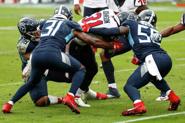 Houston Texans running back David Johnson (31) is stopped short of the goal line by Tennessee Titans free safety Kevin Byard (31) and Tennessee Titans inside linebacker Jayon Brown (55) 6)during the third quarter of an NFL football game at Nissan Stadium on Sunday, Oct. 18, 2020, in Nashville. Photo: Brett Coomer, Staff Photographer / © 2020 Houston Chronicle