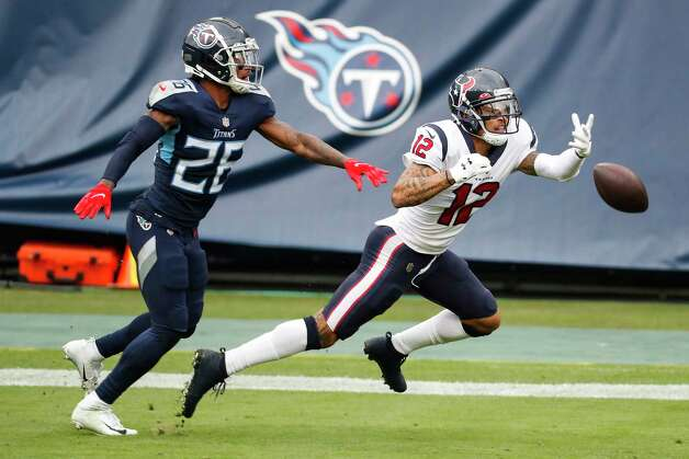 Tennessee Titans cornerback Kristian Fulton (26) breaks up a pass intended for Houston Texans wide receiver Kenny Stills (12) during the third quarter of an NFL football game at Nissan Stadium on Sunday, Oct. 18, 2020, in Nashville. Photo: Brett Coomer, Staff Photographer / © 2020 Houston Chronicle