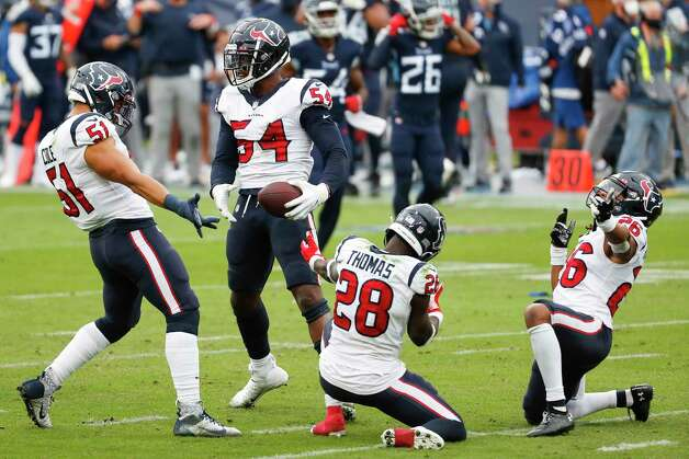 Houston Texans linebacker Jake Martin (54) celebrates after recovering a fumble by Tennessee Titans quarterback Ryan Tannehill during the third quarter of an NFL football game at Nissan Stadium on Sunday, Oct. 18, 2020, in Nashville. Photo: Brett Coomer, Staff Photographer / © 2020 Houston Chronicle
