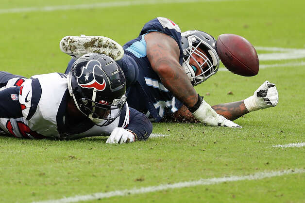 Houston Texans linebacker Jake Martin (54) fights for a loose ball with Tennessee Titans offensive guard Rodger Saffold (76) after a Ryan Tannehill fumble during the third quarter of an NFL football game at Nissan Stadium on Sunday, Oct. 18, 2020, in Nashville. Martin recovered the fumble for the turnover. Photo: Brett Coomer, Staff Photographer / © 2020 Houston Chronicle
