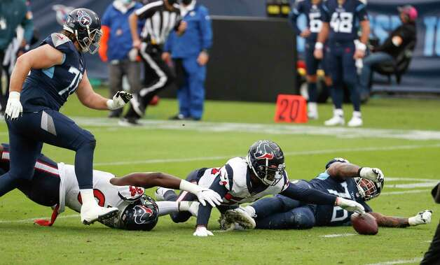 Houston Texans defensive end Charles Omenihu (94) and linebacker Jake Martin (54) fight for a loose ball with Tennessee Titans offensive guard Rodger Saffold (76) after a Ryan Tannehill fumble during the third quarter of an NFL football game at Nissan Stadium on Sunday, Oct. 18, 2020, in Nashville. Martin recovered the fumble for the turnover. Photo: Brett Coomer, Staff Photographer / © 2020 Houston Chronicle
