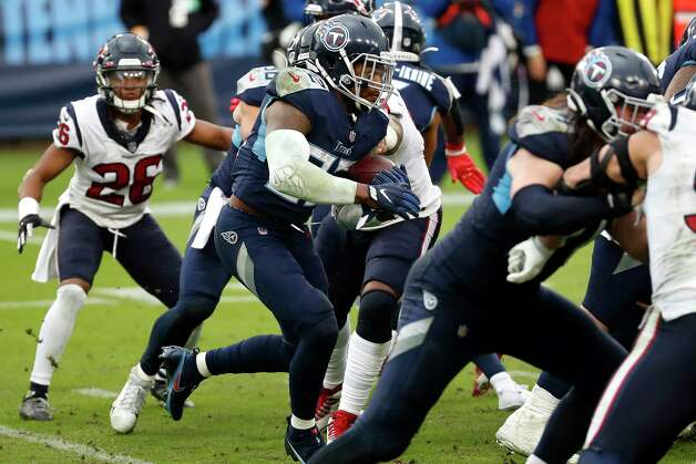 Tennessee Titans running back Derrick Henry (22) breaks through the Tennessee Titans defense for a 94-yard touchdown run during the fourth quarter of an NFL football game at Nissan Stadium on Sunday, Oct. 18, 2020, in Nashville. Photo: Brett Coomer, Staff Photographer / © 2020 Houston Chronicle