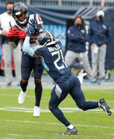 Houston Texans wide receiver Brandin Cooks (13) leaps up against Tennessee Titans cornerback Malcolm Butler (21) for a first down reception during the fourth quarter of an NFL football game at Nissan Stadium on Sunday, Oct. 18, 2020, in Nashville. Photo: Brett Coomer, Staff Photographer / © 2020 Houston Chronicle