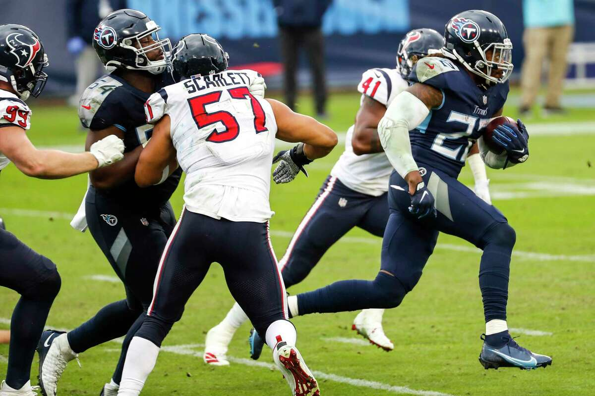 Tennessee Titans running back Derrick Henry (22) breaks through the Houston Texans defense for a 94-yard touchdown run during the fourth quarter of an NFL football game at Nissan Stadium on Sunday, Oct. 18, 2020, in Nashville.