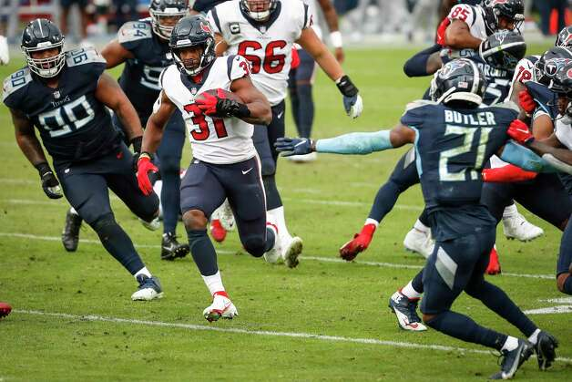Houston Texans running back David Johnson (31) runs through a hole in the Tennessee Titans defense during the fourth quarter of an NFL football game at Nissan Stadium on Sunday, Oct. 18, 2020, in Nashville. Photo: Brett Coomer, Staff Photographer / © 2020 Houston Chronicle