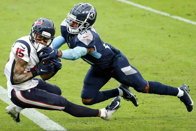 Houston Texans wide receiver Will Fuller (15) beats Tennessee Titans cornerback Malcolm Butler (21) for a 53-yard touchdown reception during the fourth quarter of an NFL football game at Nissan Stadium on Sunday, Oct. 18, 2020, in Nashville. Photo: Brett Coomer, Staff Photographer / © 2020 Houston Chronicle