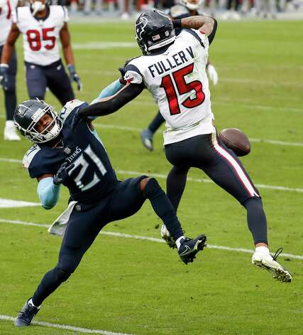 Tennessee Titans cornerback Malcolm Butler (21) breaks up a pass intended for Houston Texans wide receiver Will Fuller (15) during the fourth quarter of an NFL football game at Nissan Stadium on Sunday, Oct. 18, 2020, in Nashville. Photo: Brett Coomer, Staff Photographer / © 2020 Houston Chronicle