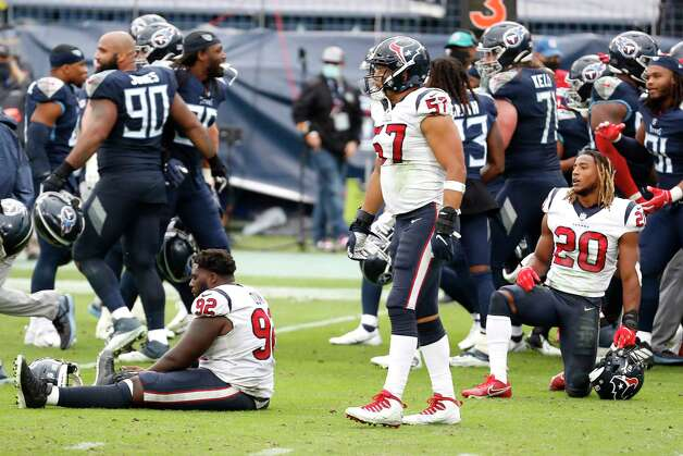 Houston Texans nose tackle Brandon Dunn (92), outside linebacker Brennan Scarlett (57) and  strong safety Justin Reid (20) pause on the field as the Tennessee Titans celebrate their overtime win in an NFL football game at Nissan Stadium on Sunday, Oct. 18, 2020, in Nashville. Photo: Brett Coomer, Staff Photographer / © 2020 Houston Chronicle