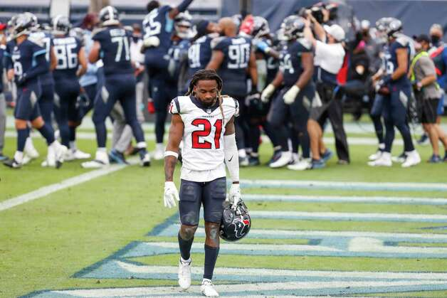 Houston Texans cornerback Bradley Roby (21) walks off the field as the Tennessee Titans celebrates running back Derrick Henry's game winning 5-yard touchdown run during overtime of an NFL football game at Nissan Stadium on Sunday, Oct. 18, 2020, in Nashville. Photo: Brett Coomer, Staff Photographer / © 2020 Houston Chronicle