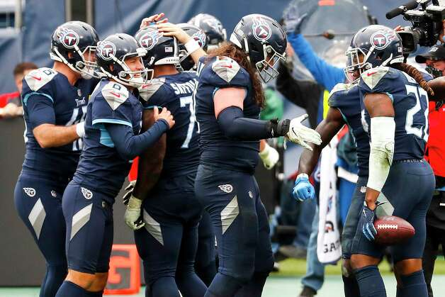The Tennessee Titans celebrate Derrick Henry's 5-yard touchdown run against the Houston Texans to win the game in overtime of an NFL football game at Nissan Stadium on Sunday, Oct. 18, 2020, in Nashville. Photo: Brett Coomer, Staff Photographer / © 2020 Houston Chronicle